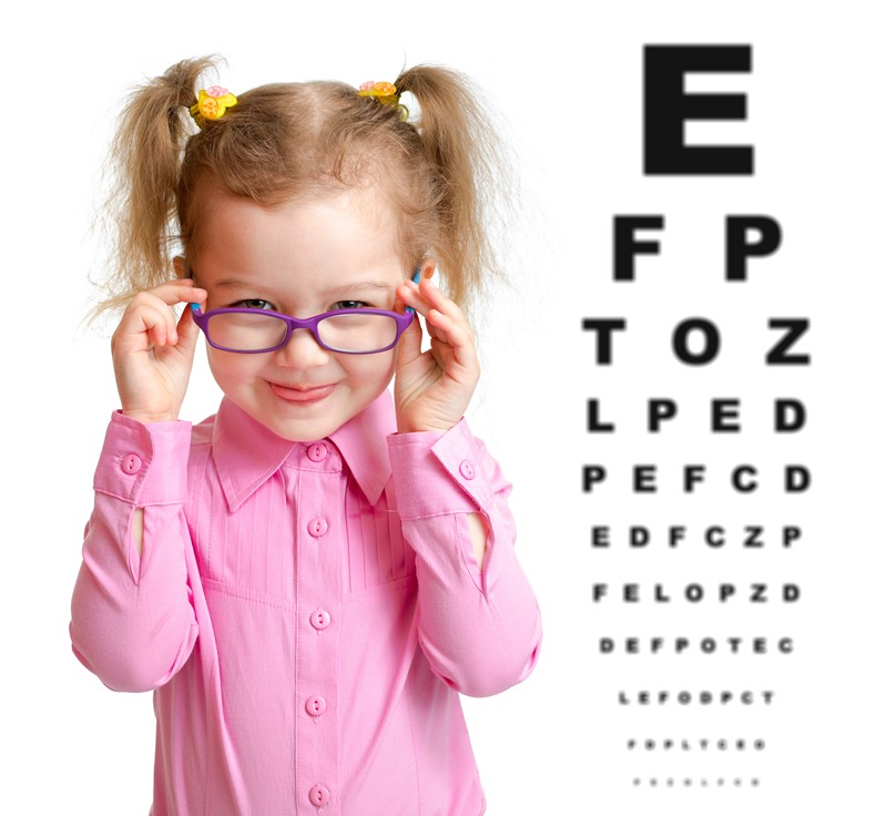 Girl with eye test chart